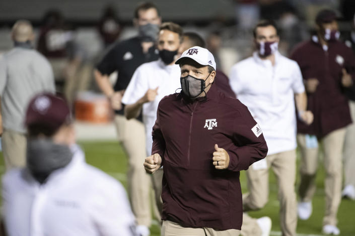 Texas A&M coach Jimbo Fisher runs off the field before the team's NCAA college football game against South Carolina on Saturday, Nov. 7, 2020, in Columbia, S.C. (AP Photo/Sean Rayford)