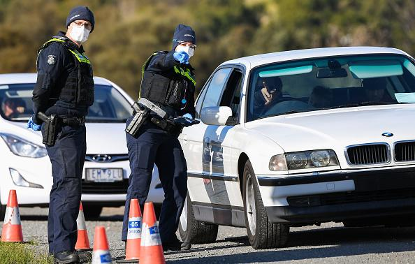 Police conduct roadside checks on the outskirts of Melbourne on the first day of the city's new lockdown after an outbreak of the COVID-19 coronavirus.