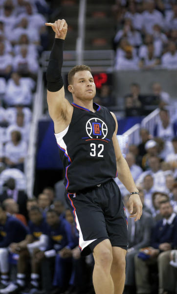 Los Angeles Clippers forward Blake Griffin follows through on a 3-point basket against the Utah Jazz during the first half in Game 3 of an NBA basketball first-round playoff series Friday, April 21, 2017, in Salt Lake City. (AP Photo/Rick Bowmer)