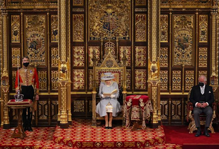 Britain's Queen Elizabeth II reads the Queen's Speech on the The Sovereign's Throne, as Britain's Prince Charles, Prince of Wales listens during the State Opening of Parliament at the Houses of Parliament in London on May 11, 2021. / Credit: CHRIS JACKSON/POOL/AFP via Getty Images