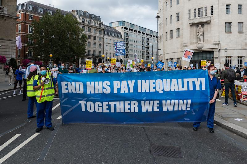 NHS staff march from BBC Broadcasting House to Trafalgar Square through central London in a protest to demand 15% pay rise for NHS workers on 12 September, 2020 in London, England. Protesters demonstrate against not being included in the government's pay deal for 900,000 public sector workers amid the sacrifices and hardship experienced during the coronavirus pandemic. (Photo by WIktor Szymanowicz/NurPhoto via Getty Images)