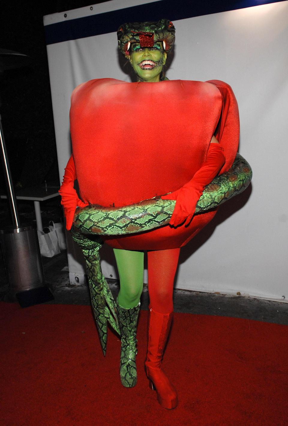 "<p>Klum came up with a way to incorporate her then eight-months-pregnant bump: Dress up as a red Delicious apple. But this isn't just any old apple; this is the Garden of Eden's forbidden fruit, thanks to the serpent addition. (Not pictured: then husband Seal as Eve.)</p> <p><strong>Get the look:</strong> <a href=""https://amzn.to/2DzzLxj"" rel=""nofollow noopener"" target=""_blank"" data-ylk=""slk:Women's Green Tights, Amazon ($12.90)"" class=""link rapid-noclick-resp"">Women's Green Tights, Amazon ($12.90)</a>, <a href=""https://www.urbanoutfitters.com/shop/urban-renewal-remnants-linen-tie-shoulder-mini-dress?category=SEARCHRESULTS&color=060"" rel=""nofollow noopener"" target=""_blank"" data-ylk=""slk:Urban Renewal Linen Tie-Shoulder Mini Dress ($49)"" class=""link rapid-noclick-resp"">Urban Renewal Linen Tie-Shoulder Mini Dress ($49)</a>, <a href=""https://amzn.to/2NLovTu"" rel=""nofollow noopener"" target=""_blank"" data-ylk=""slk:Mehron Makeup Paradise Makeup in Green, Amazon ($15.99)"" class=""link rapid-noclick-resp"">Mehron Makeup Paradise Makeup in Green, Amazon ($15.99)</a></p>"