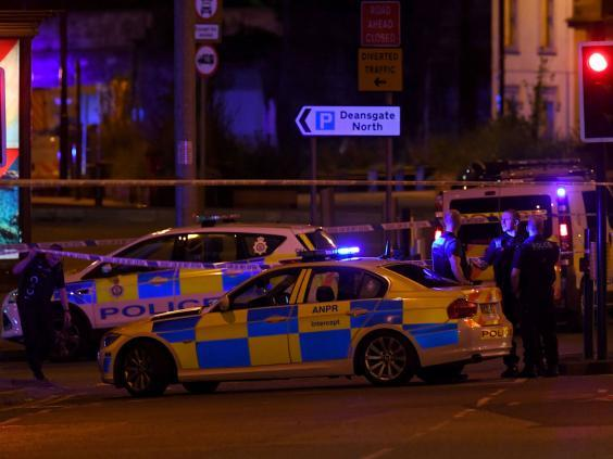 Police cordon off the area near Manchester arena after it was bombed during an Ariana Grande concert in 2017 (AFP/Getty)