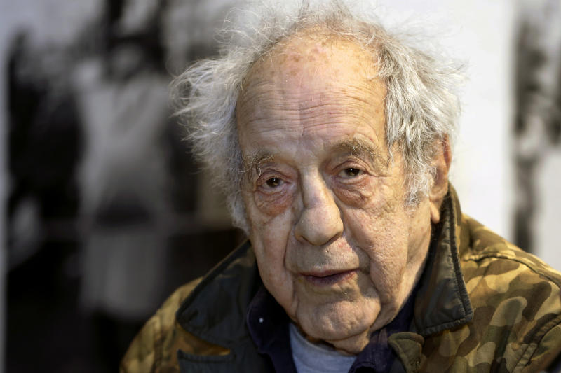 """FILE - In this Jan. 28, 2016, file photo, photographer and filmmaker Robert Frank appears at the opening of the exhibition featuring his work, """"Robert Frank: Books and Films, 1947–2016,"""" at New York University's Tisch School of the Arts in New York. Frank, one of the 20th century's greatest photographers, has died at age 94. Frank died Monday, Sept. 9, 2019, on Cape Breton Island in Nova Scotia, The New York Times reports, citing Peter MacGill, whose Manhattan gallery has represented Frank's work since 1983. (AP Photo/Kathy Willens, File)"""