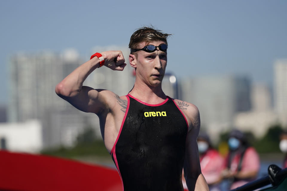 Florian Wellbrock, of Germany, flexes his arm after winning the men's marathon swimming event at the 2020 Summer Olympics, Thursday, Aug. 5, 2021, in Tokyo, Japan. (AP Photo/Jae C. Hong)