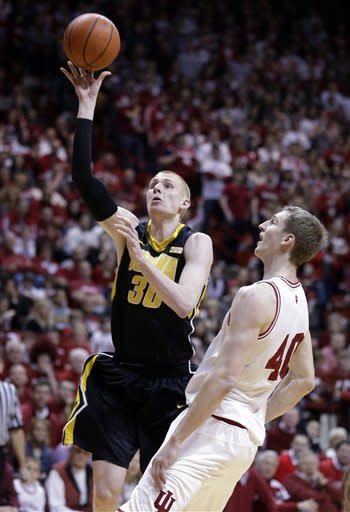 Iowa forward Aaron White, left, shoots over Indiana forward Cody Zeller in the first half of an NCAA college basketball game in Bloomington, Ind., Saturday, March 2, 2013. (AP Photo/Michael Conroy)