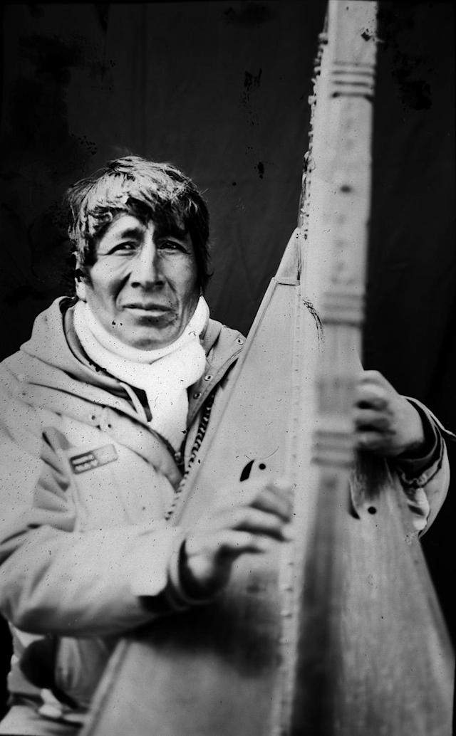 <p>Contract musician Eulogio Quispe, 54, poses for a portrait with his Peruvian harp, in the Sinakara Valley, in Peru's Cuzco region, during the Qoyllur Rit'i festival, translated from the Quechua language as Snow Star. The Peruvian variation of the harp has no pedals. (Photo: Rodrigo Abd/AP) </p>