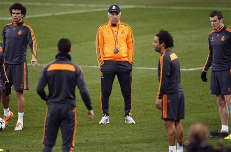 Real Madrid's coach Ancelotti watches his team during a training session in Gelsenkirchen