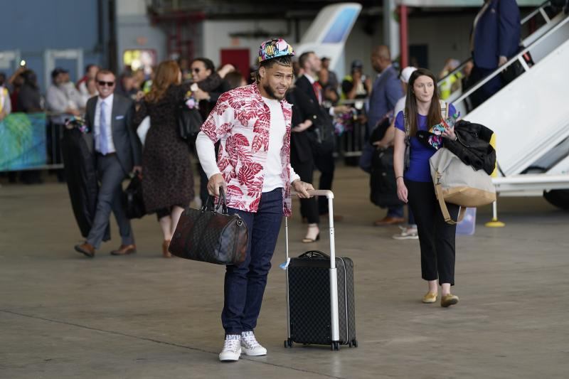 Kansas City Chiefs' Tyrann Mathieu arrives for the NFL Super Bowl 54 football game Sunday, Jan. 26, 2020, at the Miami International Airport in Miami. (AP Photo/David J. Phillip)