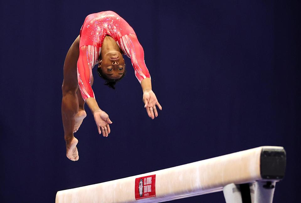 Simone Biles competes on the balance beam during the 2021 U.S. Gymnastics Olympic Trials at The Dome at America's Center on June 27, 2021, in St Louis, Missouri.