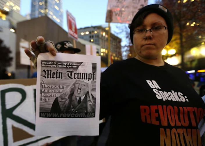 <p>A protester holds a sign with a derogatory image of President-elect Donald Trump during a protest, Wednesday, Nov. 9, 2016, in downtown Seattle. (AP Photo/Ted S. Warren) </p>