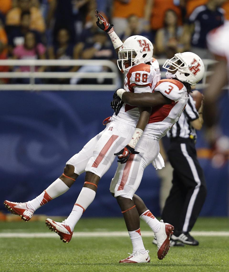 Houston's Xavier Maxwell (88) is lifted by teammate Deontay Greenberry (3) as they celebrates Maxwell's touchdown catch during the first half of an NCAA college football game against Texas-San Antonio, Saturday, Sept. 28, 2013, in San Antonio. (AP Photo/Eric Gay)