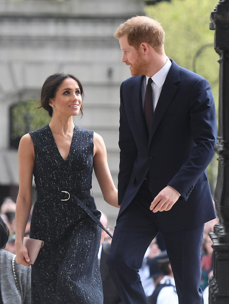 "Meghan accompanies Harry to <a href=""https://www.huffingtonpost.ca/2017/05/20/meghan-markle-pippa-middleton-wedding_n_16731626.html"" target=""_blank"" rel=""noopener noreferrer"">Pippa Middleton&rsquo;s wedding reception</a>. She did not attend the ceremony. This photo is from April 23, 2018, at a memorial service in London the couple attended."