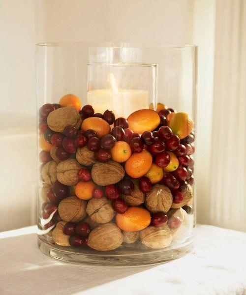 """<p>Heaped with walnuts, cranberries, and kumquats, a cylinder vase displays festive flavors. Place a tall (8- to 12-inch) pillar candle and holder inside the vase and surround with fruits and nuts.</p><p><span class=""""redactor-invisible-space""""><a class=""""link rapid-noclick-resp"""" href=""""https://www.amazon.com/Walnut-Shell-Californian-Walnuts-Shells/dp/B00BWV22DE/?th=1&tag=syn-yahoo-20&ascsubtag=%5Bartid%7C10055.g.2196%5Bsrc%7Cyahoo-us"""" rel=""""nofollow noopener"""" target=""""_blank"""" data-ylk=""""slk:SHOP WALNUTS"""">SHOP WALNUTS</a></span><br></p>"""