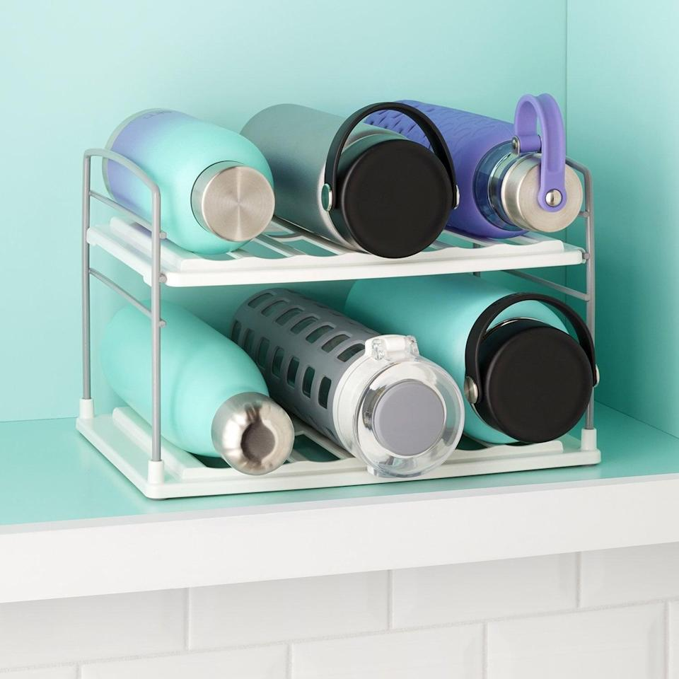 <p>If you have a huge collection of water bottles and travel mugs, you can keep it neat and tidy with this <span>UpSpace Water Bottle and Travel Mug Organizer</span> ($20). You'll be able to see your whole collection.</p>