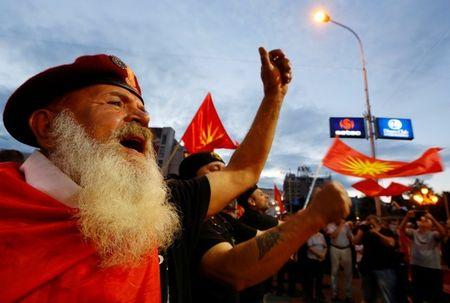Protestors shout slogans against the change of the country's constitutional name in front of the Parliament building in Skopje, Macedonia June 23, 2018. REUTERS/Ognen Teofilovski