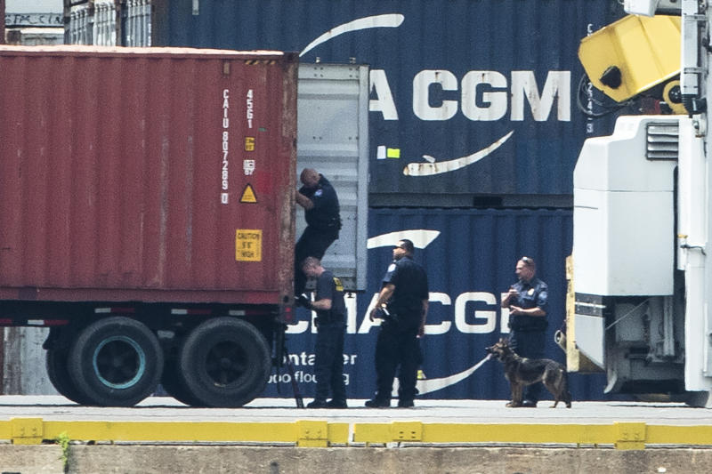 Authorities search a container along the Delaware River in Philadelphia, Tuesday, June 18, 2019. U.S. authorities have seized more than $1 billion worth of cocaine from a ship at a Philadelphia port, calling it one of the largest drug busts in American history. The U.S. attorney's office in Philadelphia announced the massive bust on Twitter on Tuesday afternoon. Officials said agents seized about 16.5 tons (15 metric tons) of cocaine from a large ship at the Packer Marine Terminal. (AP Photo/Matt Rourke)