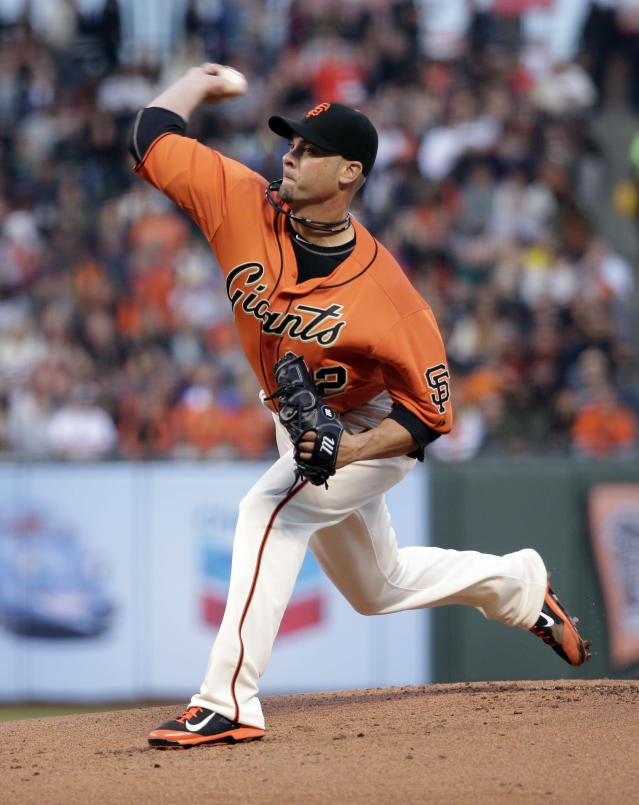San Francisco Giants starting pitcher Ryan Vogelsong throws to the Milwaukee Brewers during the first inning of a baseball game on Friday, Aug. 29, 2014, in San Francisco. (AP Photo/Marcio Jose Sanchez)