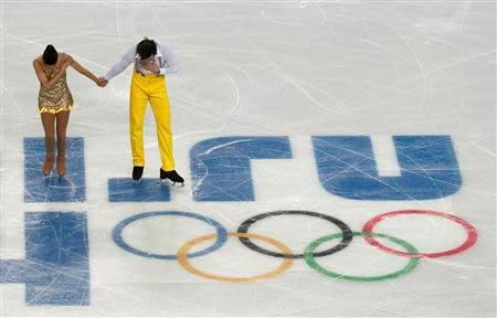 Italy's Stefania Berton (L) and Ondrej Hotarek bow during the figure skating team pairs' short program at the Sochi 2014 Winter Olympics February 6, 2014. REUTERS/David Gray