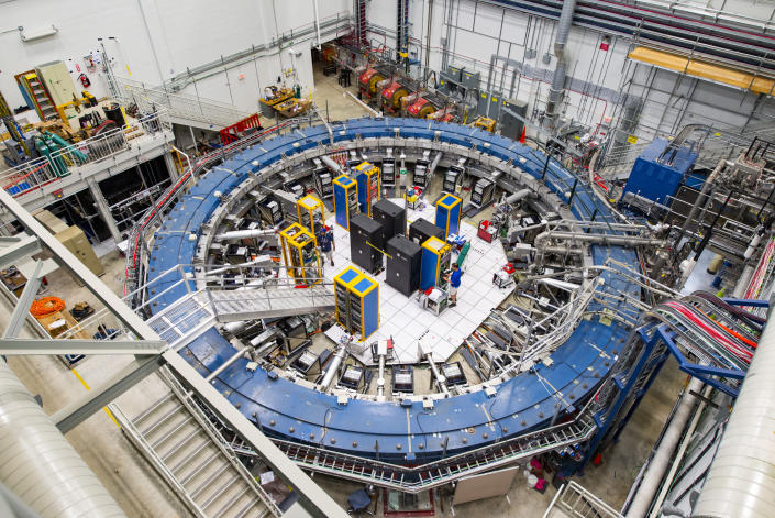 This August 2017 photo made available by Fermilab shows the Muon g-2 ring at the Fermi National Accelerator Laboratory outside of Chicago. It operates at -450 degrees Fahrenheit (-267 degrees Celsius) to detect the wobble of muons as they travel through a magnetic field. Preliminary results published in 2021 of experiments from here and the CERN facility in Europe challenge the way physicists think the universe works, a prospect that has the field of particle physics both baffled and thrilled. (Reidar Hahn/Fermilab via AP)