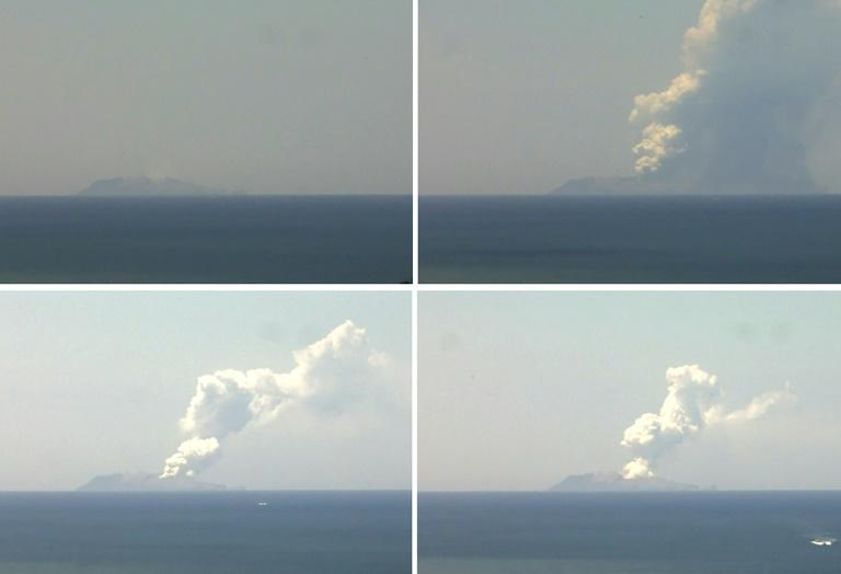 This combination of handout images from a webcam belonging to the Institute of Geological and Nuclear Sciences shows the volcano on New Zealand's White Island spewing steam and ash