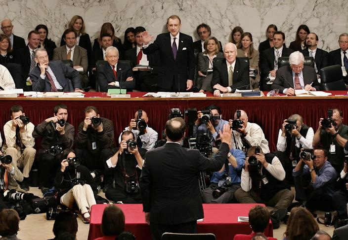 FILE - In this Jan. 9, 2006 file photo Senate Judiciary Committee Chairman, Sen. Arlen Specter, R-Pa., facing camera, swears in Supreme Court nominee Samuel Alito, back to camera, during his confirmation hearing before the committee on Capitol Hill in Washington. Former U.S. Sen. Arlen Specter, longtime Senate moderate and architect of one-bullet theory in JFK death, died Sunday, Oct. 14, 2012. He was 82. (AP Photo/J.Scott Applewhite, File)
