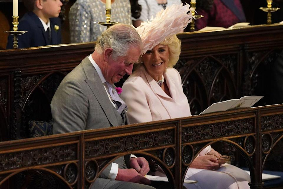 "<p>Charles and Camilla shared a smile during<a href=""https://www.townandcountrymag.com/royal-wedding-2018/"" rel=""nofollow noopener"" target=""_blank"" data-ylk=""slk:Prince Harry's wedding to Meghan Markle"" class=""link rapid-noclick-resp""> Prince Harry's wedding to Meghan Markle</a> at Windsor Castle.</p>"