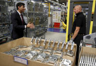 Britain's Chancellor of the Exchequer Rishi Sunak, left, speaks to employees during a visit to Worcester Bosch factory to promote the initiative, Plan for Jobs, in Worcester, England, Thursday July 9, 2020. (Phil Noble/Pool via AP)