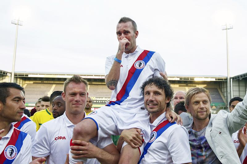 (L-R) Giovanni van Bronckhorst of Team Fernando Ricksen, Kiki Musampa of Team Fernando Ricksen, Kevin Hofland of Team Fernando Ricksen, Fernando Ricksen of Team Fernando Ricksen, Mark van Bommel of Team Fernando Ricksen, Anatoliy Tymoshchuck of Team Fernando Ricksen during the Fernando Ricksen benefit game on May 25, 2014 at the Trendwork Arena in Sittard, The Netherlands.(Photo by VI Images via Getty Images)