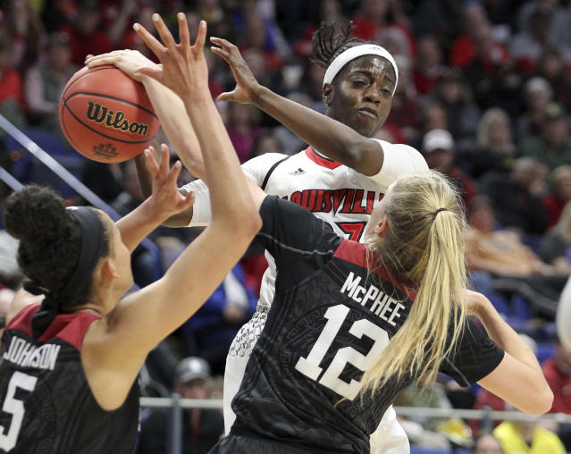 Louisville's Jazmine Jones, top, is defended by Stanford's Brittany McPhee (12) and Kaylee Johnson during the first half of an NCAA women's college basketball tournament regional semifinal Friday, March 23, 2018, in Lexington, Ky. (AP Photo/James Crisp)