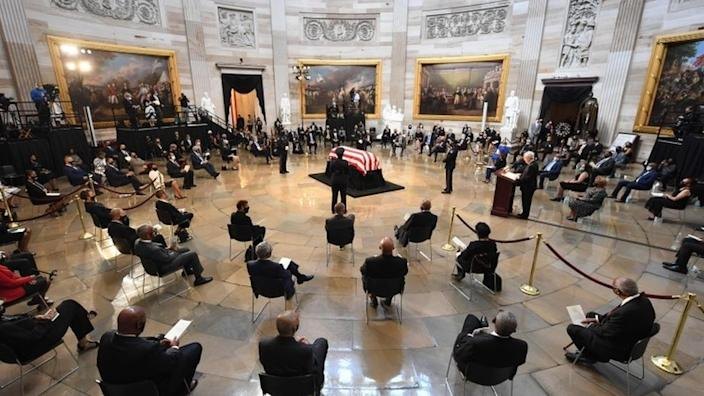 People pay their respects to the flag-draped casket of the late Rep. John Lewis