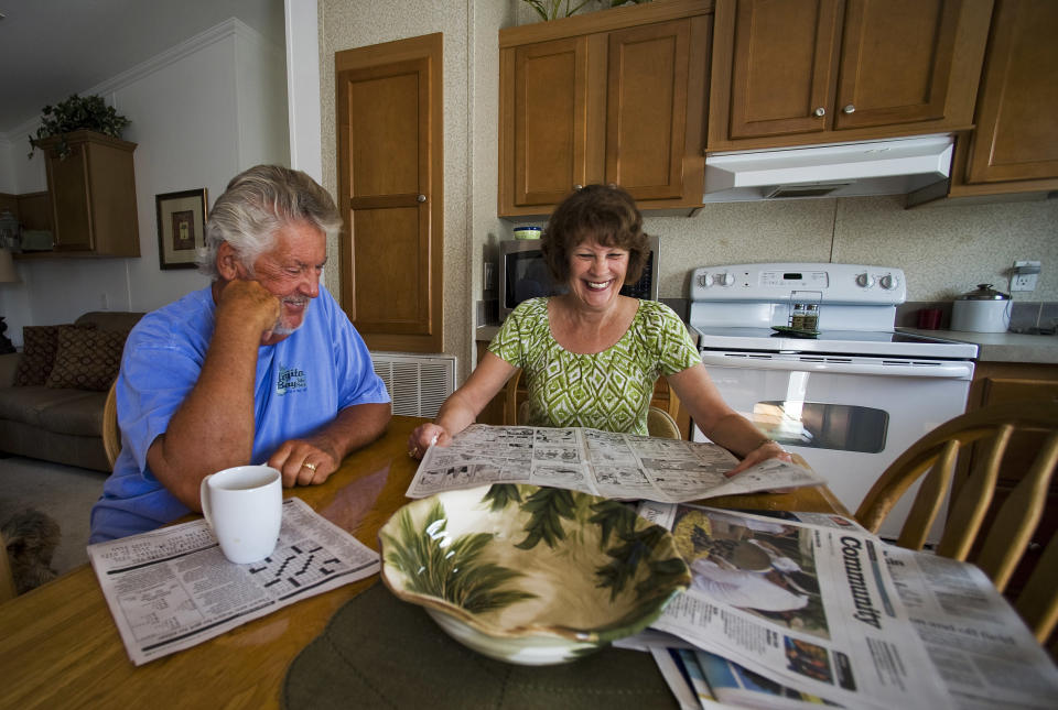 Mark Findlay and his wife Delores Findlay, of Erie, Pennsylvania, read the morning newspaper inside their home at Limetree Park where they spend the winter months in Bonita Springs, Florida, March 23, 2012. Medicare and Social Security, the massive programs that pay benefits to tens of millions of older Americans, are contentious issues in the 2012 presidential campaign. Seniors want the nation?s sputtering economy to be fixed, but not at their expense.   REUTERS/Steve Nesius  (UNITED STATES - Tags: ELECTIONS POLITICS SOCIETY)