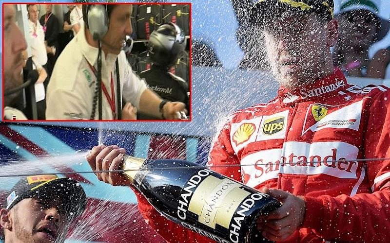 Sebastian Vettel celebrates while Toto Wolff (inset) bangs his fist against his desk - EPA