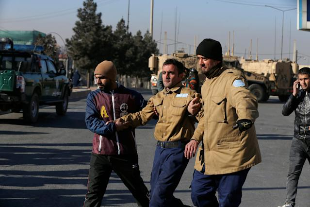 <p>A wounded security guard receives help after being rescued from Kabul's Intercontinental Hotel during an attack by gunmen in Kabul, Afghanistan January 21, 2018. (Photo: Omar Sobhani/Reuters) </p>