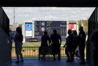 Fans walk along the Mezzanine during the sixth inning of a spring baseball game between the New York Yankees and the Toronto Blue Jays at George M. Steinbrenner Field Sunday, Feb. 28, 2021, in Tampa, Fla. (AP Photo/Frank Franklin II)