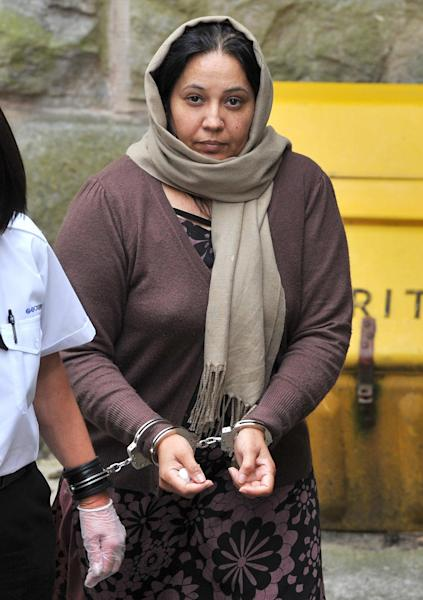 """FILE - This is a June 19, 2012 file photo of Farzana Ahmed the mother of murdered teen-ager Shafilea Ahmed. A British court on Friday Aug. 3, 2012 found a mother and father guilty of murdering their teen-age daughter Shafilea Ahmed in a so-called honor killing. The Chester Crown Court found that Iftikhar and Farzana Ahmed, both originally from Pakistan, suffocated their 17-year-old daughter, Shafilea, in 2003. During the trial, Shafilea's sister Alesha told the jury that her parents pushed Shafilea onto the couch and she heard her mother say """"just finish it here"""" as they forced a plastic bag into the girl's mouth. (AP Photo/Martin Rickett/PA, File)"""