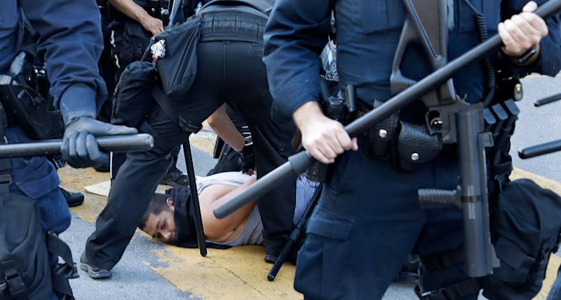 A protester is arrested on Friday in San Jose, California. (Photo: ASSOCIATED PRESS)