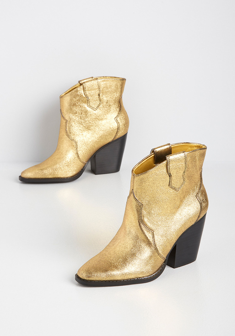 """<h3>Western</h3><br>The undeniable breakout trend of last fall is here to stay (because, honestly, it was always there right in front of our eyes to begin with). Cowboy boots offer a hefty dose of style while retaining a comfortably low profile.<br><br><strong>Chinese Laundry</strong> Walking on Gold Dust Ankle Boot, $, available at <a href=""""https://go.skimresources.com/?id=30283X879131&url=https%3A%2F%2Fwww.modcloth.com%2Fshop%2Fshoes%2Fchinese-laundry-walking-on-gold-dust-ankle-boot-in-gold%2F171425.html"""" rel=""""nofollow noopener"""" target=""""_blank"""" data-ylk=""""slk:ModCloth"""" class=""""link rapid-noclick-resp"""">ModCloth</a>"""