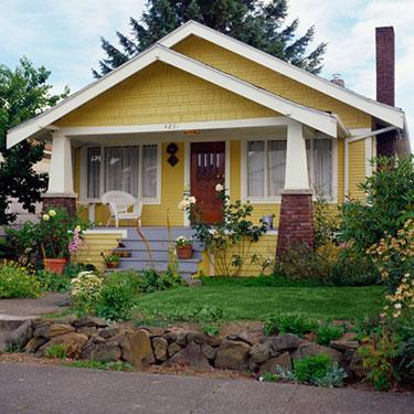 Yellow-bungalow-style-house-with-garden-exterior-view_web