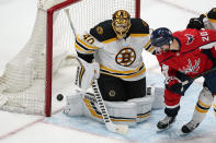 Washington Capitals center Lars Eller (20) watches the puck get past Boston Bruins goaltender Tuukka Rask (40) on a shot by Washington Capitals right wing Garnet Hathaway during the first period of Game 2 of an NHL hockey Stanley Cup first-round playoff series Monday, May 17, 2021, in Washington. (AP Photo/Alex Brandon)