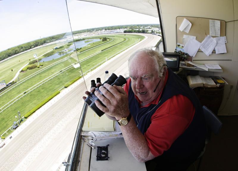"FILE - In this May 26, 2008, file photo, Belmont Park track announcer Tom Durkin looks down at the homestretch while calling the first hose race of the day at Belmont Park in New York. After two decades or so as the signature voice for the sport's premier events, but more sleepless nights and anxious moments than he could bear, Durkin simply said, ""enough."" (AP Photo/Julie Jacobson, File)"