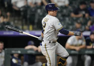 Milwaukee Brewers' Luis Urias watches his single off Colorado Rockies relief pitcher Daniel Bard during the ninth inning of a baseball game Thursday, June 17, 2021, in Denver. The Rockies won 7-3. (AP Photo/David Zalubowski)