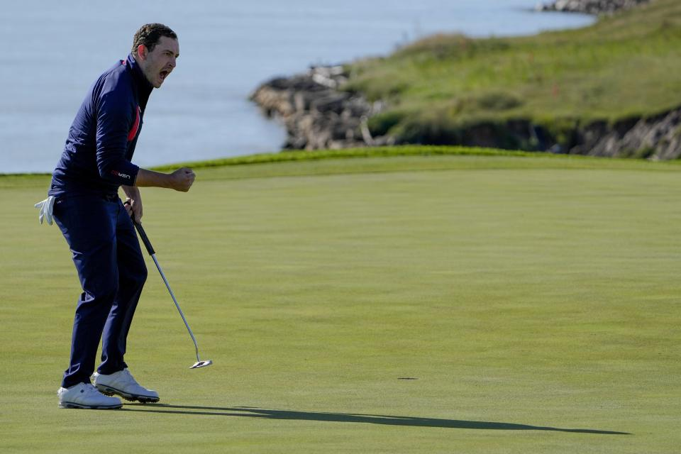 Team USA's Patrick Cantlay reacts after making a putt on the eighth hole during a foursomes match the Ryder Cup at the Whistling Straits Golf Course Saturday, Sept. 25, 2021, in Sheboygan, Wis. (AP Photo/Jeff Roberson)