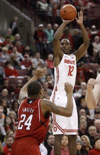 Ohio State's Sam Thompson, right, shoots over Nebraska's Dylan Talley during the first half of an NCAA college basketball game in Columbus, Ohio, Wednesday, Jan. 2, 2013. (AP Photo/Paul Vernon)