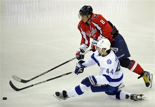 Washington Capitals left wing Alex Ovechkin (8), of Russia, battles for the puck against Tampa Bay Lightning center Nate Thompson (44) during the second period of an NHL hockey game, Friday, Jan. 13, 2012, in Washington. (AP Photo/Nick Wass)