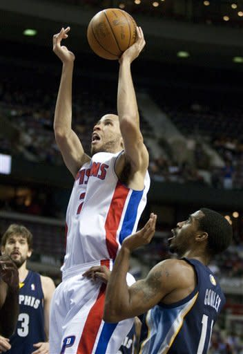 Detroit Pistons' Tayshaun Prince, left, gets off a shot over Memphis Grizzlies' Mike Conley, right, in the second half of an NBA basketball game Friday, Jan. 20, 2012, in Auburn Hills, Mich. The Grizzlies defeated the Pistons 98-81. (AP Photo/Duane Burleson)