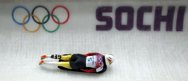 Germany's Anja Huber speeds down the track in the women's skeleton event at the 2014 Sochi Winter Olympics February 14, 2014. REUTERS/Fabrizio Bensch (RUSSIA - Tags: SPORT SKELETON OLYMPICS)