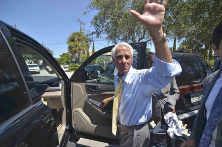 Former Florida Governor Charlie Crist waves after meeting supporters outside the North Miami Public Library in Miami