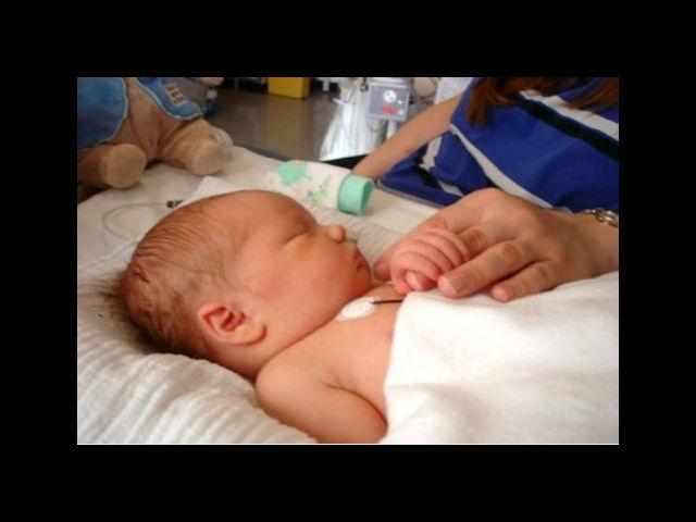 <b>The Miracle Baby:</b><br> A day after Adam Cheshire was born, he slipped into a coma. Quarantined in an incubator in his first week of life, Adam's mother Charlotte, could do little more than stroke his feet as he slept, hoping her touch would stir some life into his tiny body. It would. After seven days, she was permitted to hold him. In her arms, he opened his eyes and woke from his coma