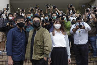 Hong Kong activists, from left, Joshua Wong, Ivan Lam and Agnes Chow arrive at a court in Hong Kong, Monday, Nov. 22. 2020. The trio appear at court for their trial as they faces charges related to the besieging of a police station during anti-government protests last year. (AP Photo/Vincent Yu)